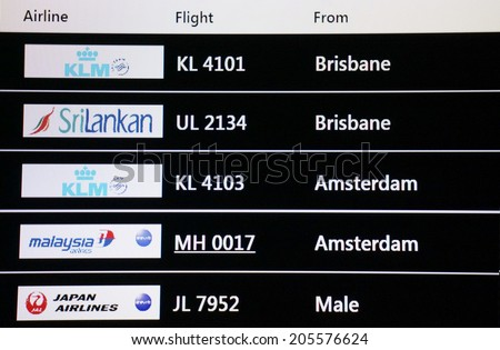 KUALA LUMPUR INTERNATIONAL AIRPORT - JULY 18, 2014: Flights arrival information timetable showing MH17 in KLIA, Sepang, Malaysia. MH17 crashes on Ukraine-Russia border, killing 295 people - stock photo