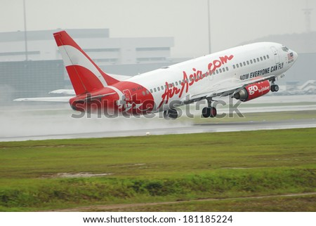 KUALA LUMPUR INTERNATIONAL AIRPORT (KLIA), SEPANG, MALAYSIA - APRIL 15: AirAsia plane Boeing 737-322 takes off at KLIA airport on April 15, 2006 in KLIA, Sepang, Malaysia. - stock photo