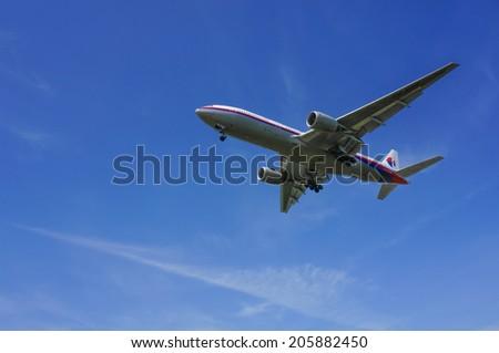KUALA LUMPUR INTERNATIONAL AIRPORT (KLIA), SEPANG, MALAYSIA- JULY 19: Boeing 777-200ER (9M-MRP) Malaysia Airlines flies over KLIA on July 19, 2014 in KLIA, Sepang, Malaysia. - stock photo