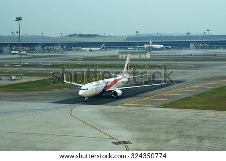 KUALA LUMPUR INTERNATIONAL AIRPORT (KLIA), SEPANG, MALAYSIA - SEPT  01: Boeing 737 MAS (Malaysia Airlines System) lands at KLIA airport during haze day on September 1, 2015 in KLIA, Sepang, Malaysia.