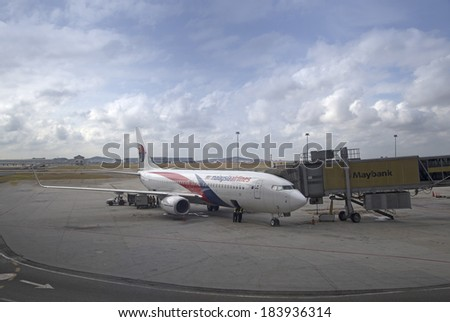 KUALA LUMPUR INTERNATIONAL AIRPORT - MARCH 17: A Malaysia Airlines plane prepares for passengers to board, as ground crew prepares the plane for the next flight, MARCH 17, 2014 in KLIA, Malaysia. - stock photo