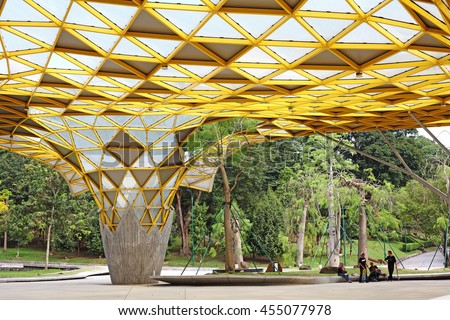KUALA LUMPUR - JAN 10, 2016: Youths at the garden pavilion in Kuala Lumpur Perdana Botanical Gardens in Jalan Tembusu. The garden formally known as the Lake Gardens was built in 1888 by A.R.Venning.