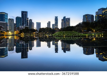 KUALA LUMPUR - JANUARY 23: A blue hour view of Symphony Lake KLCC with reflections during sunrise on January 23, 2016 in Kuala Lumpur.