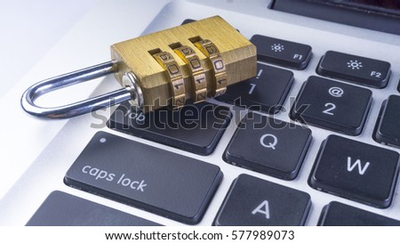 KUALA LUMPUR, January 2017 - Closeup of computer security concept with a closed padlock on the keyboard. Selective focus