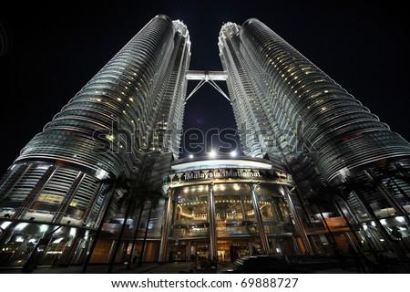 KUALA LUMPUR - JANUARY 22: Petronas Twin Towers - tallest twin buildings in the world at the night January 22, Kuala Lumpur, Malaysia - stock photo