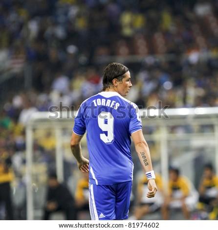 KUALA LUMPUR - JULY 21 : Chelsea football club player Fernando Torres looks back during a friendly match against Malaysia XI on July 21, 2011 in Kuala Lumpur, Malaysia. Chelsea FC won 1-0. - stock photo