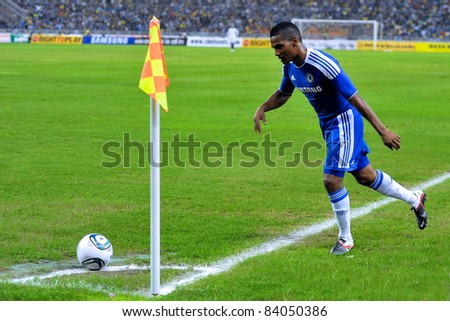 KUALA LUMPUR, JULY 21 : Chelsea's Florent Malouda in action during a preseason match against Malaysia on July 21, 2011 in Kuala Lumpur, Malaysia. Chelsea won 1-0 - stock photo