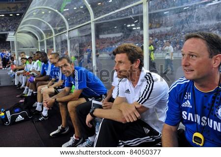 KUALA LUMPUR, JULY 21 : Chelsea's manager Andre Villas-Boas (white shirt) sitting on bench during a preseason match against Malaysia on July 21, 2011 in Kuala Lumpur, Malaysia. Chelsea won 1-0 - stock photo