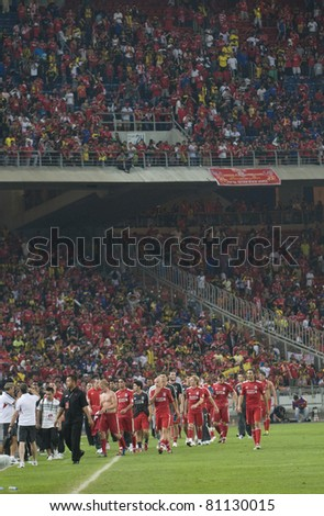 KUALA LUMPUR - JULY 16 : Liverpool football club players walk on after a friendly match against Malaysia XI on July 16, 2011 in Kuala Lumpur, Malaysia. Liverpool won 6-3.
