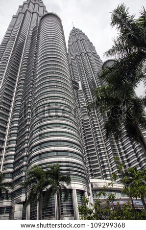 KUALA LUMPUR - JULY 20: Petronas Towers is one of the most popular visitor attractions in Malaysia.  The famous landmark is the world's tallest twin tower, on  July 20, 2012 in Kuala Lumpur. - stock photo