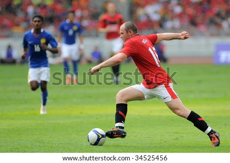 KUALA LUMPUR - JULY 18 : Wayne Rooney of Manchester United team in action during friendly match against Malaysia at National Stadium, July 18, 2009 in Kuala Lumpur.  Manchester won 3-2.