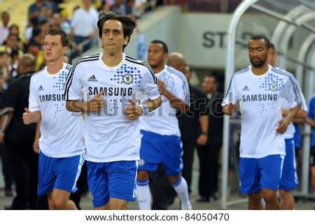 KUALA LUMPUR, JULY 21 : Yossi Benayoun and Chelsea player walked into the stadium during a preseason match against Malaysia on July 21, 2011 in Kuala Lumpur, Malaysia. Chelsea won 1-0 - stock photo