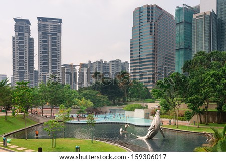 KUALA LUMPUR - JUN 15: KLCC Park is a public park located near Petronal twin towers on Jun 15, 2013 in Kuala Lumpur, Malaysia. 20 hectares park was designed by Roberto Burle Marx in 1980.