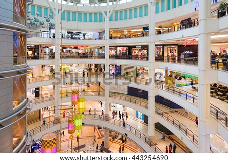 KUALA LUMPUR - JUNE 15, 2016: Unidentified people walk on 6 floors of the Suria KLCC shopping mall. The mall is located in the Kuala Lumpur City Centre district near the famous Petronas Towers.