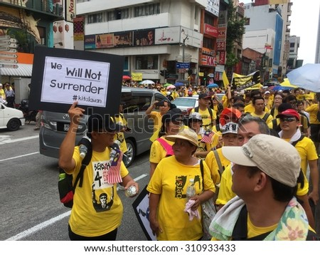 Kuala Lumpur, Malayia 29 August 2015 : Yellow shirt Supporters displaying banners supporting Bersih 4 Rally for Free Fair Elections. Bersih organized Rallies 29/30 August in cities around Malaysia