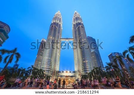 KUALA LUMPUR, MALAYSIA - APRIL 13: beatiful light show of Petronas Twin Towers on April 13, 2013, Kuala Lumpur Malaysia. - stock photo