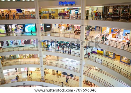 KUALA LUMPUR, MALAYSIA - APRIL 23, 2014: inside Suria KLCC shopping mall. Suria KLCC shopping centre is a six-storey building at the foot of the Petronas Twin Towers in Kuala Lumpur city centre