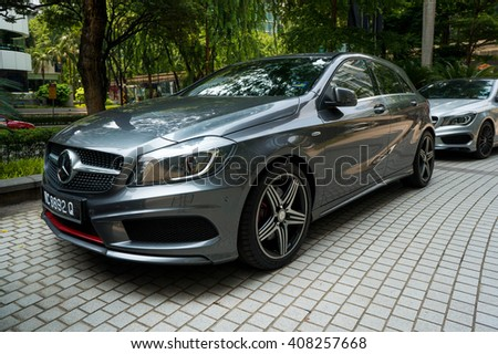 KUALA LUMPUR, MALAYSIA - APRIL 11, 2016: Mercedes-Benz A250 parking on the side road. Photo at Jalan P Ramlee road about 600m to KLCC