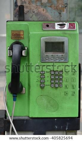 KUALA LUMPUR, MALAYSIA - April 10, 2016. Old public phone at the roadside in Kuala Lumpur. - stock photo