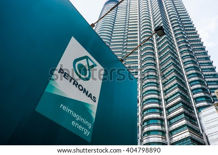 KUALA LUMPUR, MALAYSIA - APRIL 11 : PETRONAS logo in-front of Twin Tower KLCC on April 11, 2016 in KL, Malaysia. PETRONAS is a Malaysian oil and gas company that was founded on 17 August 1974 - stock photo