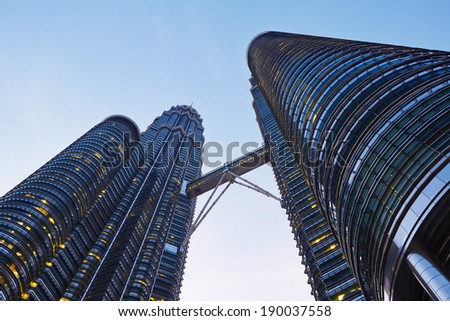 KUALA LUMPUR, MALAYSIA - April 25: Petronas Twin Towers on April 25, 2014 in Kuala Lumpur, Malaysia. The skyscrapers height are 451.9m and were the tallest buildings in the world during 1998-2004.  - stock photo