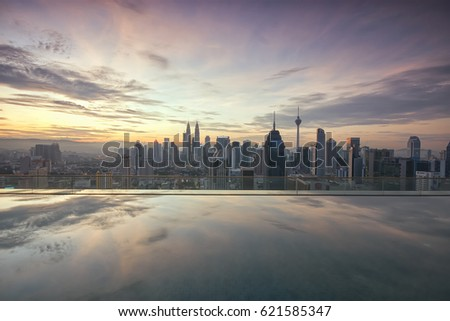 kuala lumpur,malaysia -april 15th 2017(sunrise moments of kuala lumpur city centre with reflection on the pools)
