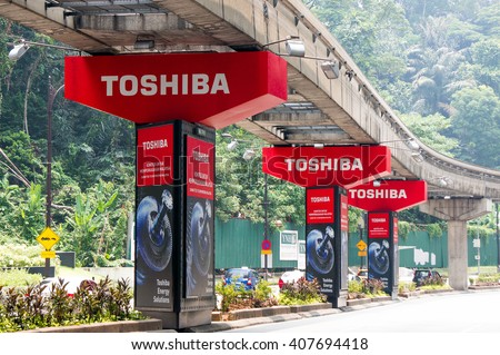 KUALA LUMPUR, MALAYSIA - April 10, 2016. Toshiba advertise on pillars bridge in Kuala Lumpur. Toshiba is a Japanese multinational conglomerate. Headquarters in Tokyo and founded since 1875. - stock photo