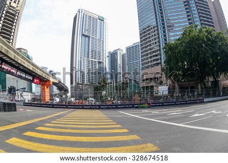 KUALA LUMPUR, MALAYSIA - AUG 09, 2015: An unidentified single-seater race car races in the city street circuit in the Formula Masters China Series Race of the 2015 Kuala Lumpur City Grand Prix. - stock photo