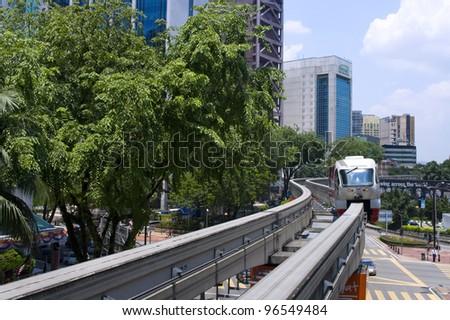 KUALA LUMPUR, MALAYSIA -AUG 19: KL Monorail on Aug 19, 2011 in Kuala Lumpur, Malaysia. Train arrives at a train station. Kuala Lumpur metro or rapid transit system consists of 6 metro lines. - stock photo