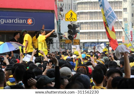 KUALA LUMPUR, MALAYSIA - AUGUST 29, 2015 : A Bersih protest leader giving a speech to protestors during the Bersih 4.0 rally in Kuala Lumpur. - stock photo