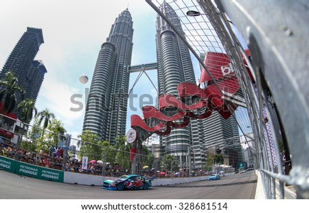 KUALA LUMPUR, MALAYSIA - AUGUST 09, 2015: Chaz Mostert from the Pepsi Max Crew team races in the V8 Supercars Street Challenge at the 2015 Kuala Lumpur City Grand Prix. - stock photo