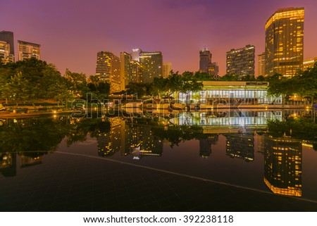 KUALA LUMPUR, MALAYSIA - AUGUST 5, 2015 : KLCC Lake Symphony views and reflection during sunrise long exposure. Lake Symphony is a 10,000 square meter man made lake with water fountains.