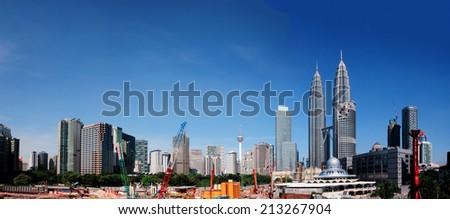 KUALA LUMPUR, MALAYSIA - AUGUST 24: Kuala Lumpur Cityscape view from street on August 24, 2014  - stock photo