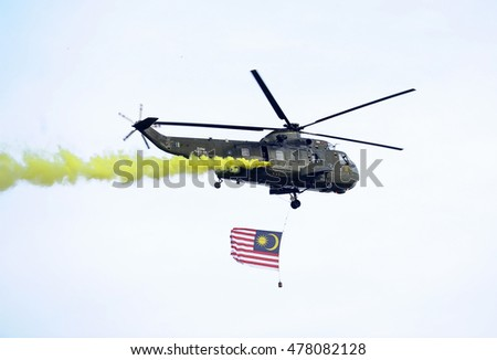 KUALA LUMPUR, MALAYSIA - August 31,2016 : Military helicopters flying the flag of malaysia in air show.