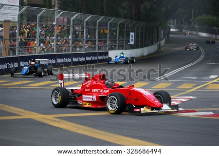 KUALA LUMPUR, MALAYSIA - AUGUST 09, 2015: Single seater racing cars race in the city street circuit in the Formula Masters China Series Race at the 2015 Kuala Lumpur City Grand Prix. - stock photo