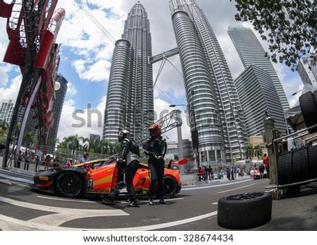KUALA LUMPUR, MALAYSIA - AUGUST 09, 2015: The Lamborghini car of drivers Anthony Liu and Davide Rizzo make a pit stop in the Lamborghini Blancpain Super Trofeo Race of the 2015 KL City Grand Prix. - stock photo