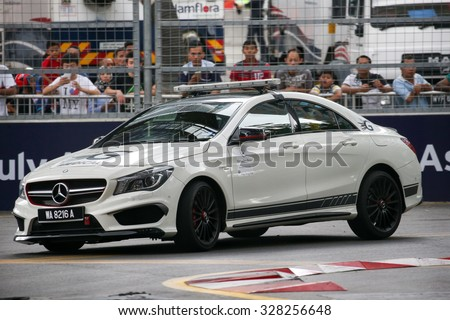 KUALA LUMPUR, MALAYSIA - AUGUST 08, 2015: The Medical Car inspects the race track and emergency medical services before the V8 Supercars Street Challenge of the 2015 Kuala Lumpur City Grand Prix. - stock photo