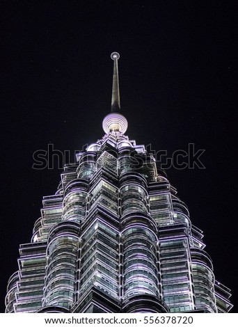 KUALA LUMPUR, MALAYSIA - AUGUST 4, 2016. Top of one of the Petronas towers at night