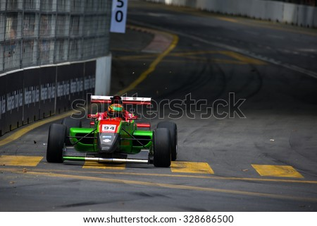 KUALA LUMPUR, MALAYSIA - AUGUST 09, 2015: William Lok in a single seater racing car race in the city street circuit in the Formula Masters China Series Race at the 2015 Kuala Lumpur City Grand Prix. - stock photo