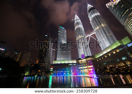 KUALA LUMPUR, MALAYSIA - CIRCA JANUARY 2015: Petronas Twin Towers at night. Petronas Twin Towers were the tallest buildings (452 m) in the world from 1998 to 2004.