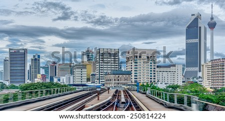 KUALA LUMPUR, MALAYSIA - DEC 25: Monorail train moving through the city in Kuala Lumpur on Dec 25, 2012 in Kuala Lumpur, Malaysia. Train transportation serves approximately 690,000 passengers daily. - stock photo