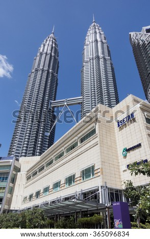 KUALA LUMPUR, MALAYSIA - Dec 30, 2015 - Petronas Twin Towers with its shopping centre, Suria, the surrounding Central Business District buildings, making the most photographed landmark of the city