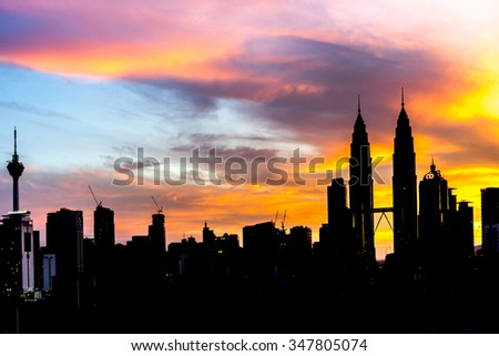 KUALA LUMPUR, MALAYSIA - DEC 6, 2015: Silhouette building of KLCC Twin Towers with orange sunrise background with natural lighting.
