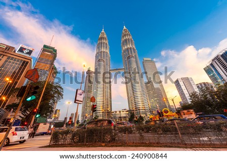 KUALA LUMPUR, MALAYSIA - DECEMBER 20: Night time of Petronas Twin Towers on December 20, 2014 in Kuala Lumpur, Malaysia. This building (451.9m/88 floors) is the tallest twin buildings in the world  - stock photo