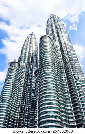 KUALA LUMPUR, MALAYSIA - FEB10, 2015: Cloudscape view of the Petronas Twin Towers at KLCC City Center. The most popular tourist destination in Malaysian capital - stock photo