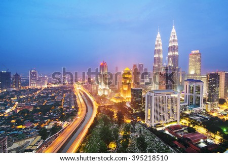 KUALA LUMPUR, MALAYSIA - FEB27, 2016: Cloudscape view of the Petronas Twin Towers at KLCC City Center. The most popular tourist destination in Malaysian capital