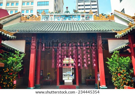Kuala Lumpur,Malaysia- February 16, 2014: A man would like to taking some photos in Guan Di temple which is located in Jalan Tun H.S.Lee,a small street parallel to the busy Petaling Street.