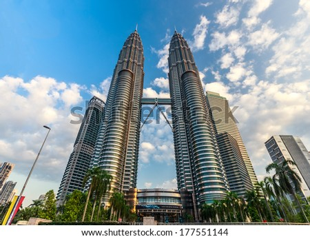 KUALA LUMPUR, MALAYSIA - February 16:Evening time of Petronas Twin Towers on February 16,2014 in KL Malaysia. Petronas Twin Towers were the tallest buildings (452m) in the world during 1998-2004. - stock photo