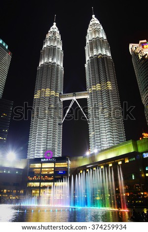 KUALA LUMPUR, MALAYSIA - FEBRUARY 01, 2014: Petronas Towers at night. Petronas Towers, Malay: Menara Petronas is the tallest buildings in the world from 1998 to 2004.
