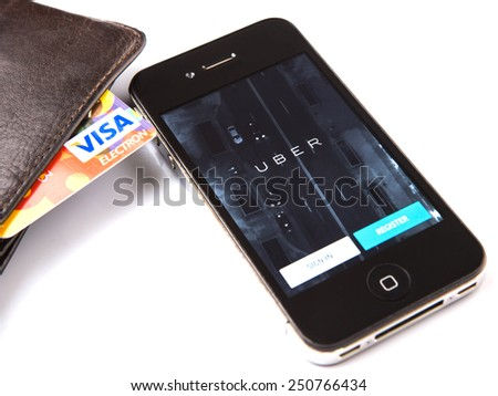 KUALA LUMPUR, MALAYSIA - FEBRUARY 8TH 2015. Visa credit card and Uber mobile apps.  Uber is smartphone app-based transportation network and taxi company operating in 53 countries around the world.